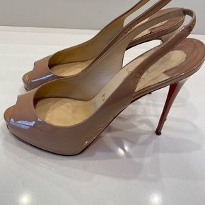 Red bottom peep toes in nude